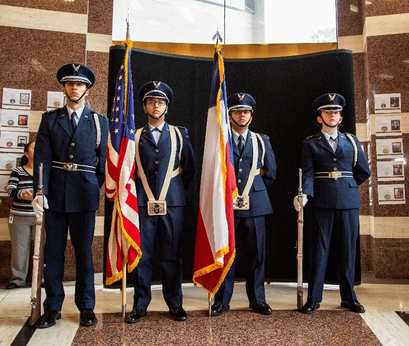Honor Guard holding the American and Texas flags