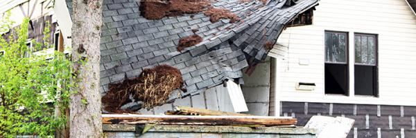The roof of a home falling into disrepair