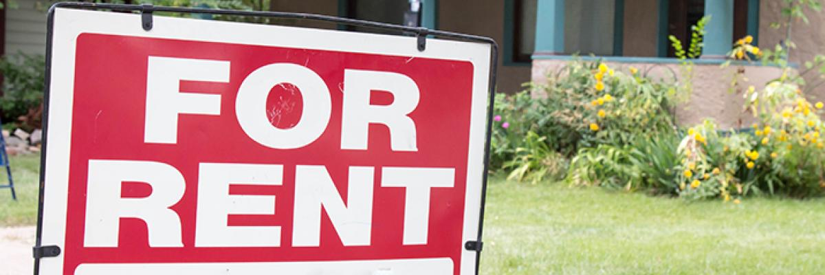 """For Rent"" sign in a yard"